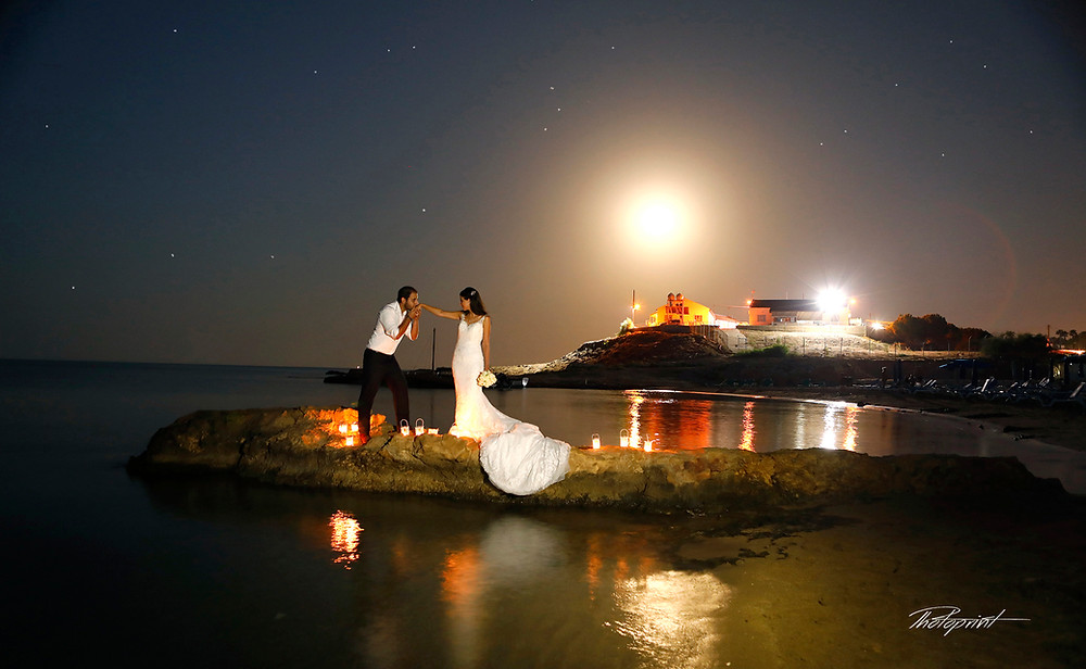 Beautiful and gentle wedding photo session outdoors of the elegant couple on protaras beach