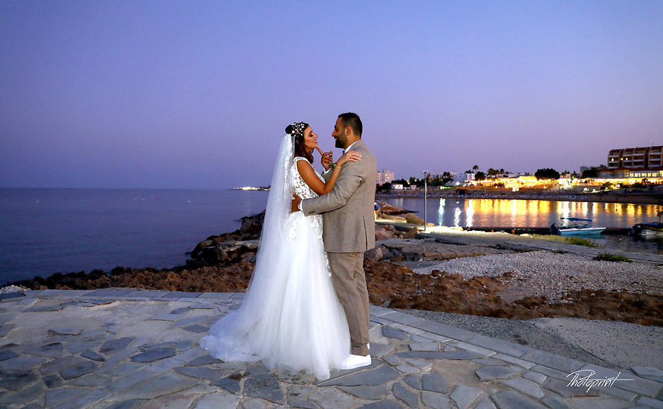 Groom and Bride by the beach at night after the wedding | cyprus wedding photography