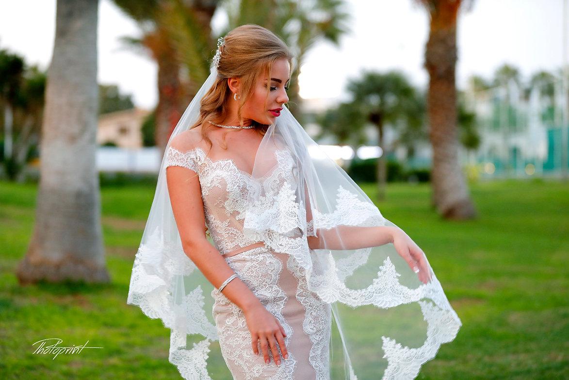 Gorgeous bride in wedding dress with bouquet of flowers posing | lebanese wedding in cyprus, civil ayia napa  wedding photography,ayia napa Best wedding photos cyprus