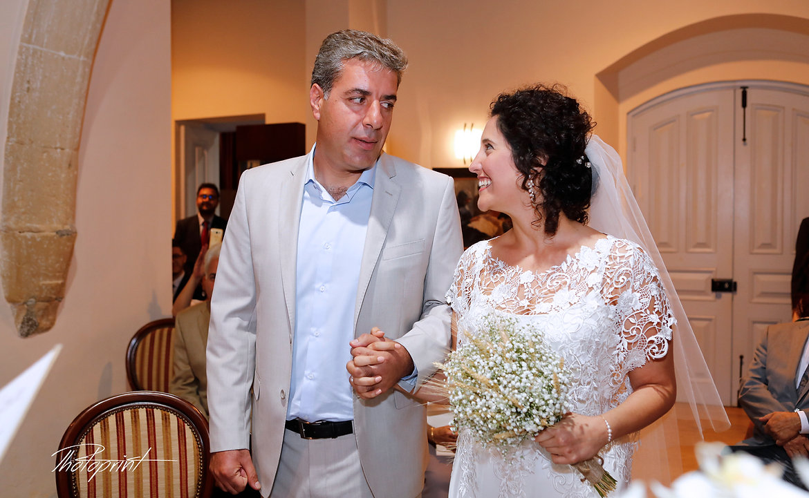 Beautiful and gentle wedding ceremony photo session indoors of the elegant lebanese couple at Larnaca Municipality | pictures ideas of  lebanese bride and groom in larnacal cyprus