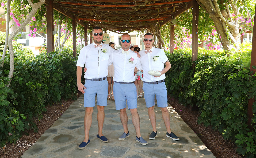 Happy groom with groomsmen  before the wedding ceremony proceed for the wedding at Nissi Beach Resort in ayia napa
