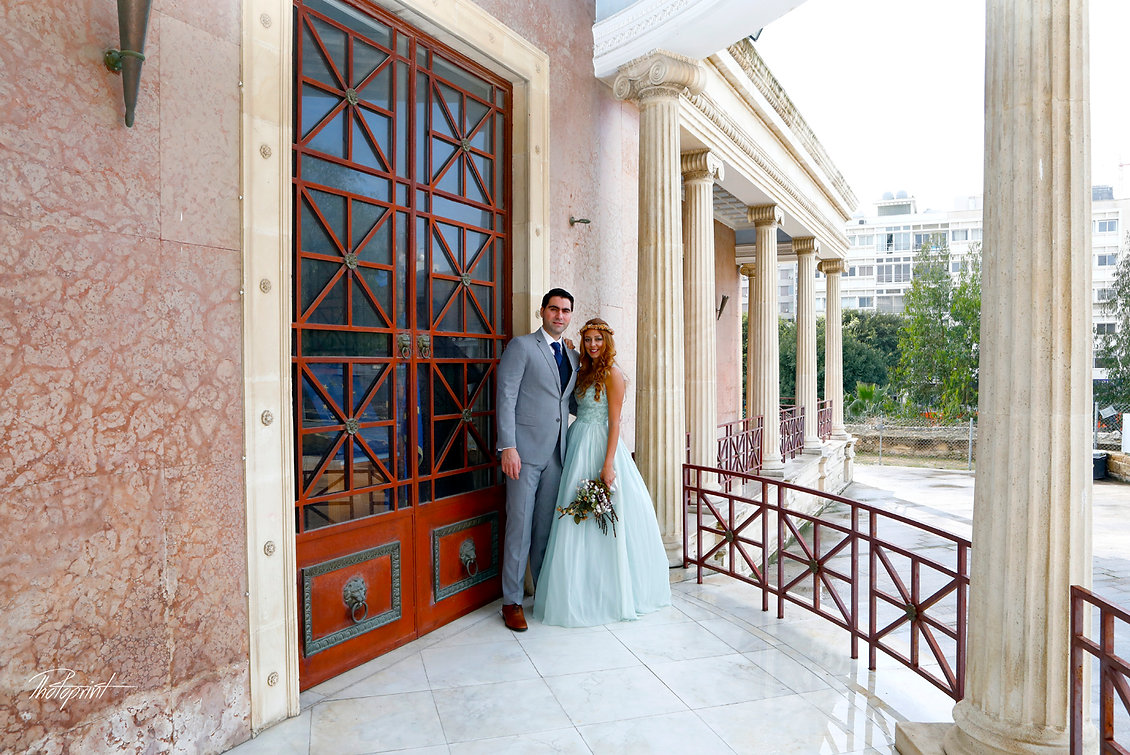 Happy couple after the wedding ceremony outside the Nicosia Municipality town Hall | wedding photographer photos in town hall nicosia, wedding photographer nicosia prices, wedding photographer nicosia prices