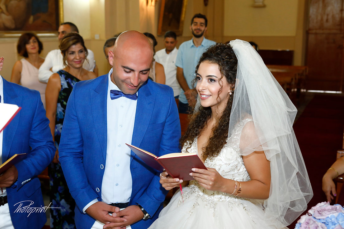 Wedding ceremony inside of the  St Joseph church in Larnaca, Cyprus wedding couple are swearing lifetime loyalty | lebanon wedding photographers  larnaca, lebanese weddings in cyprus