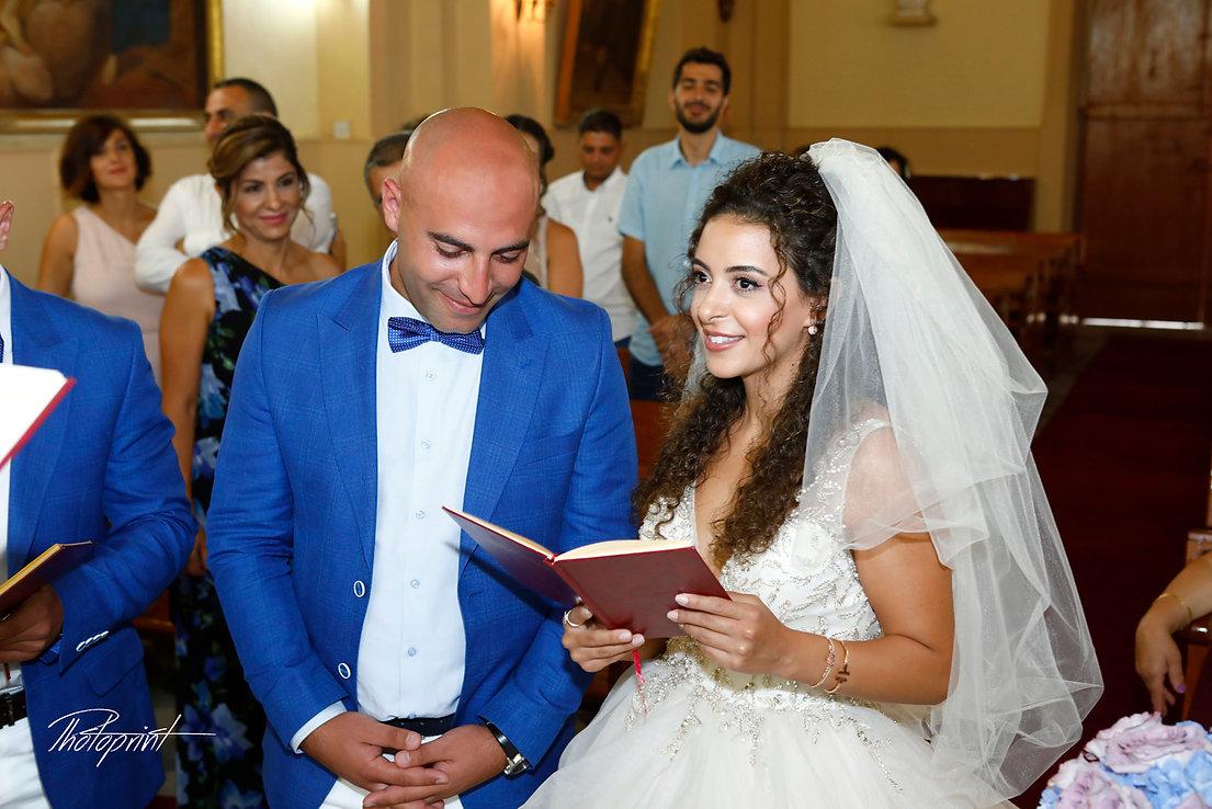 Wedding ceremony inside of the  St Joseph church in Larnaca,Cyprus wedding couple are swearing lifetime loyalty | lebanon wedding photographers  larnaca, lebanese weddings in cyprus