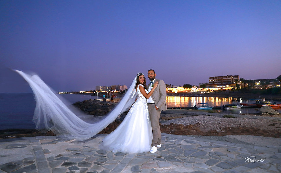 Beautiful and gentle wedding photo session outdoors of the elegant couple at night by the beach | cyprus weddings photographers