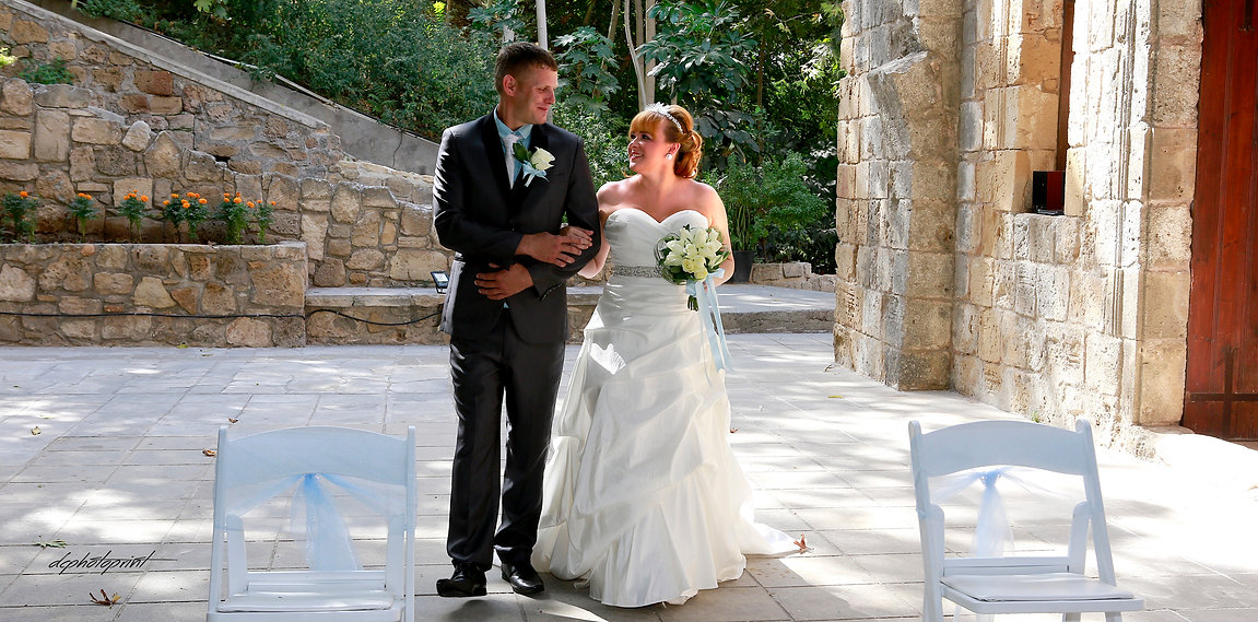 Couple standing outdoor in Ottoman baths Paphos holding hands | civil weddings in Paphos cyprus, city town hall marriage at paphos