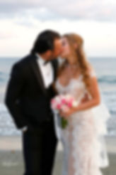 Bride and groom kissing passionately  |  larnaca town hall civil wedding cost, larnaca town hall civil weddings, Larnaca Beach Weddings, cyprus wedding photographers prices