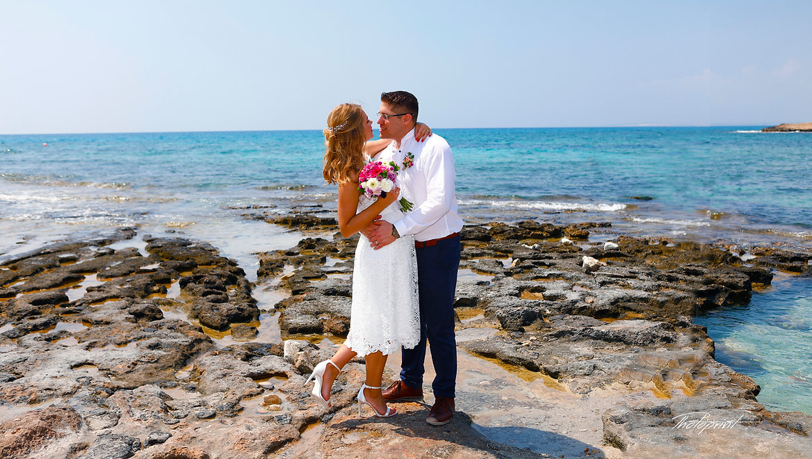 Beautiful and gentle wedding photo session outdoors of the elegant couple, bride in a white dress with veil holding a bouquet  |  best wedding photography at ayia napa cyprus, best wedding photography websites, bridal photographer in agia napa, bridal photography in agia napa