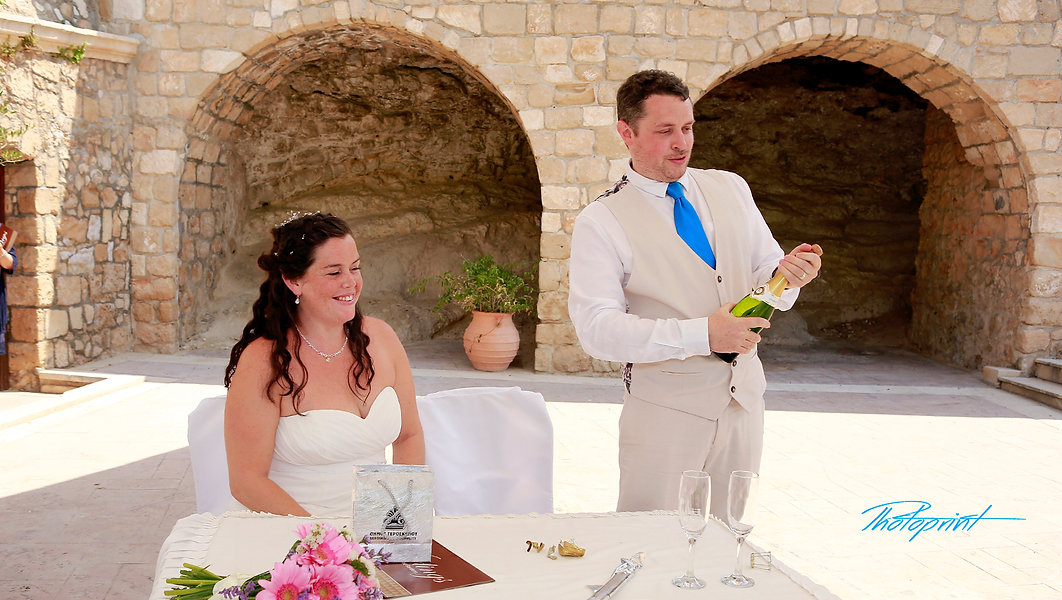 Happy groom opening champagne bottle at Geroskipou Municipality in Paphos | Paphos best wedding photography photographer, Paphos best wedding photographer, Paphos best wedding photography
