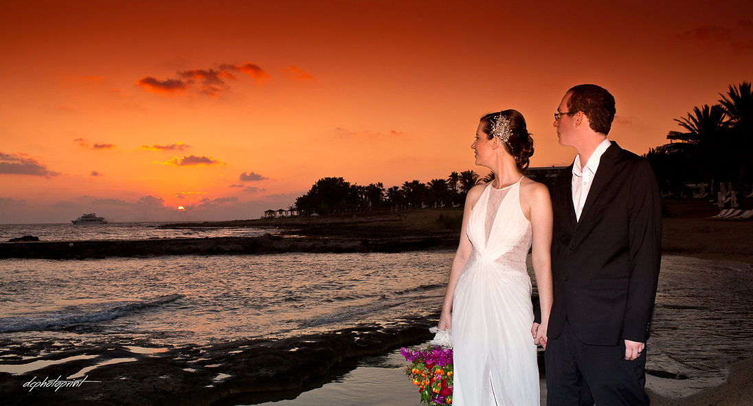 Picture of Elegant beautiful Just married romantic Bride at Sunset on a Beautiful Mediterranean Paphos Beach | cyprus sunset images wedding photographers paphos, best paphos cyprus wedding photography websites