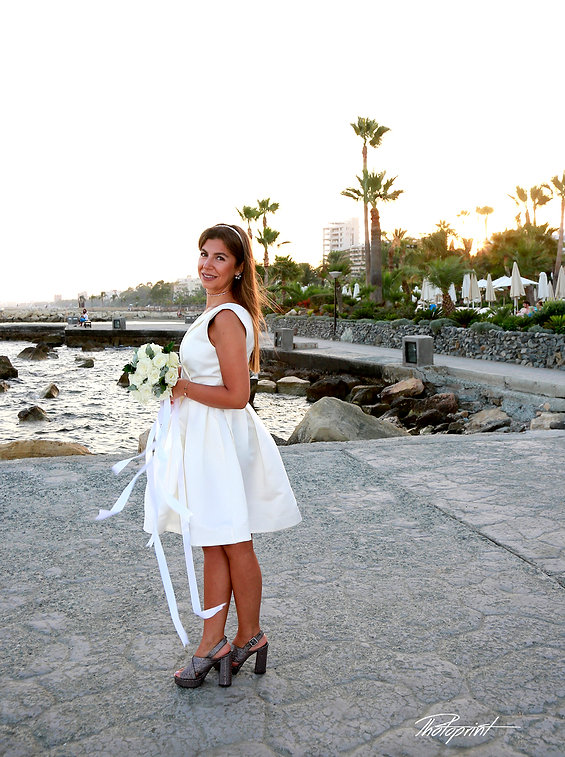 Beautiful bride in wedding dress and bridal bouquet, on photo session outdoors at the Amathus beach hotel in Limassol | weddings photographer limassol cyprus,  wedding venues in limassol