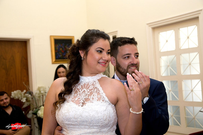 Happy bride and groom show us the wedding rings after ceremony in Paphos Municipality |  cyprus wedding photographer cheap paphos, wedding venues paphos cyprus