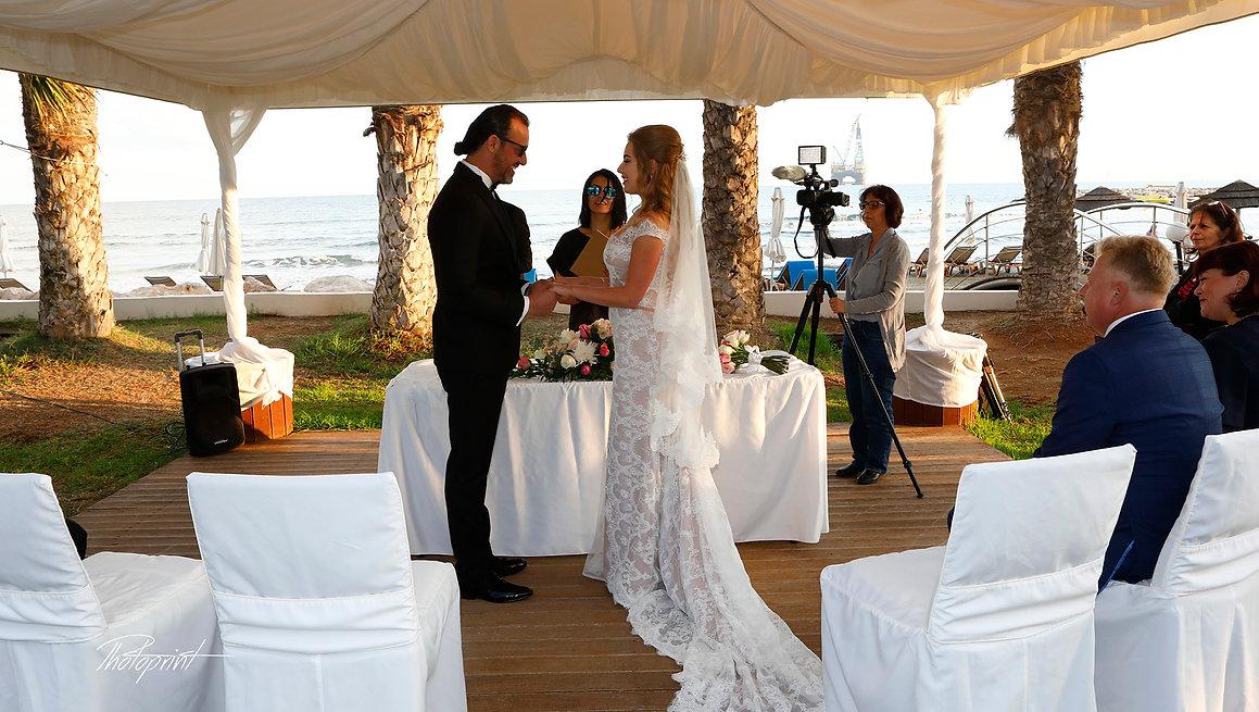 picture of happy couple in sunglasses on the ceremony  |  weddings photographers larnaca, wedding on a budget larnaca, first choice weddings larnaca