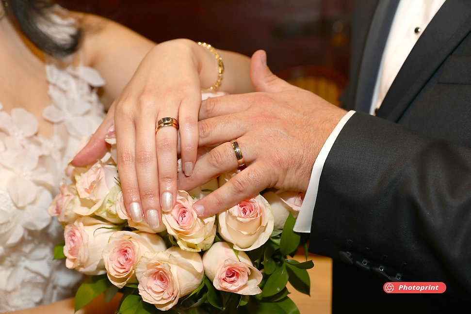 Bride and groom show us the wedding rings after ceremony in Larnaca.