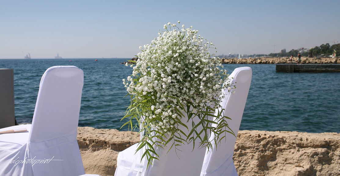 Wedding decor with flowers on tropical beach of  AMATHUS BEACH HOTEL, Cyprus Limassol  | wedding limassol  photographers, wedding limassol photography cyprus