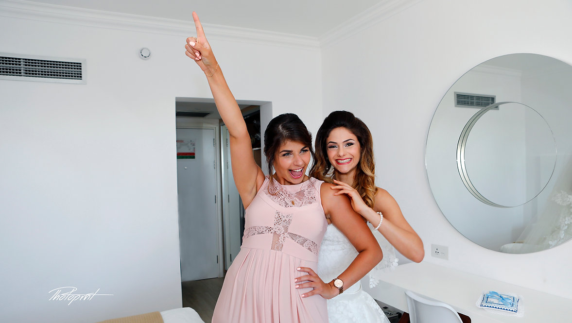 Bride and bridesmaid have a small party before the wedding ceremony | wedding photographer in protaras cyprus, cyprus cheap wedding photographer price protaras