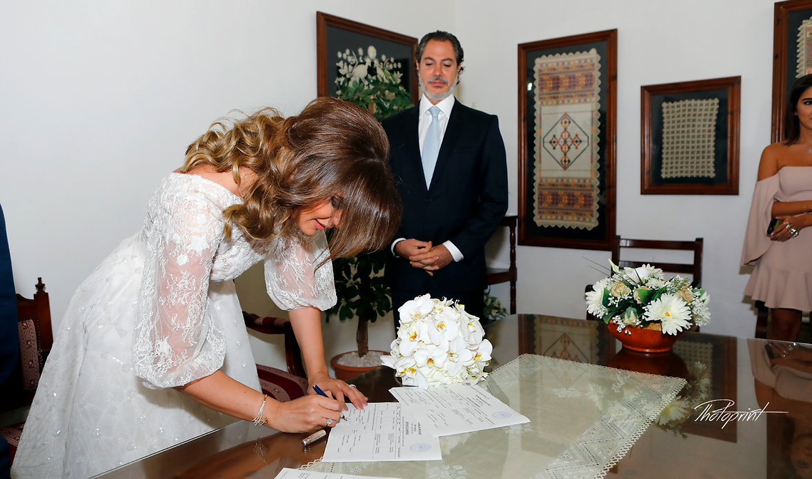 Happy young Bride signing wedding registration form in Municipality of Yermasoyia | famous wedding pics photographers Yermasoyia cyprus, professional wedding photographers in Yermasoyia