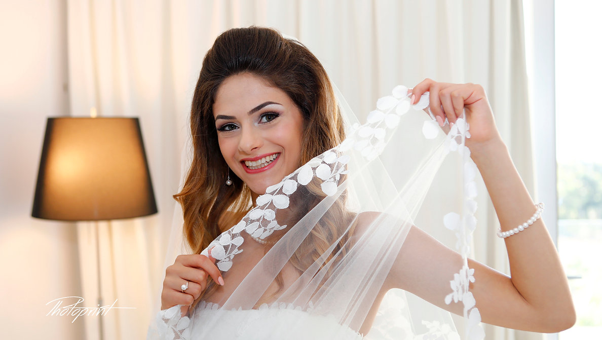 Happy brunette bride Close-up portrait of gorgeous beautiful bride in white dress with amazing hair style and make up, holdinge spinning around with veil | wedding photographers protaras cyprus, wedding photography protaras, wedding photography protaras cyprus