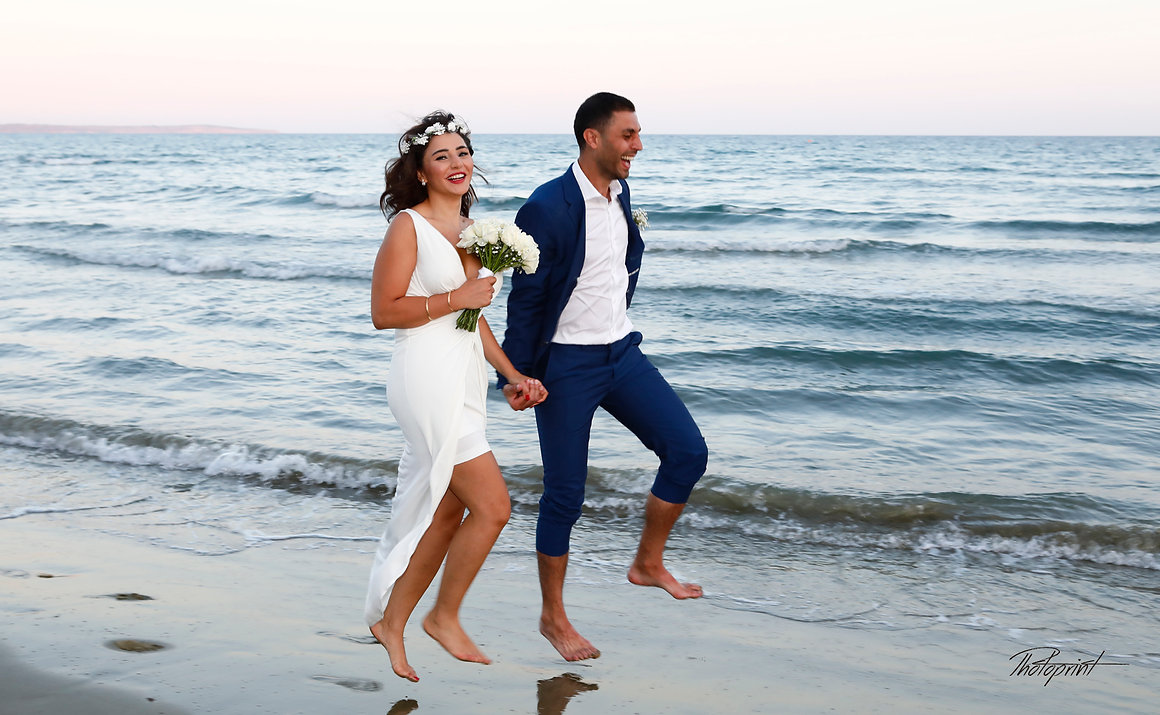 Beautiful wedding couple walking on beach at sunset holding hands |  best wedding venue Larnaca, city town hall marriage at  Larnaca