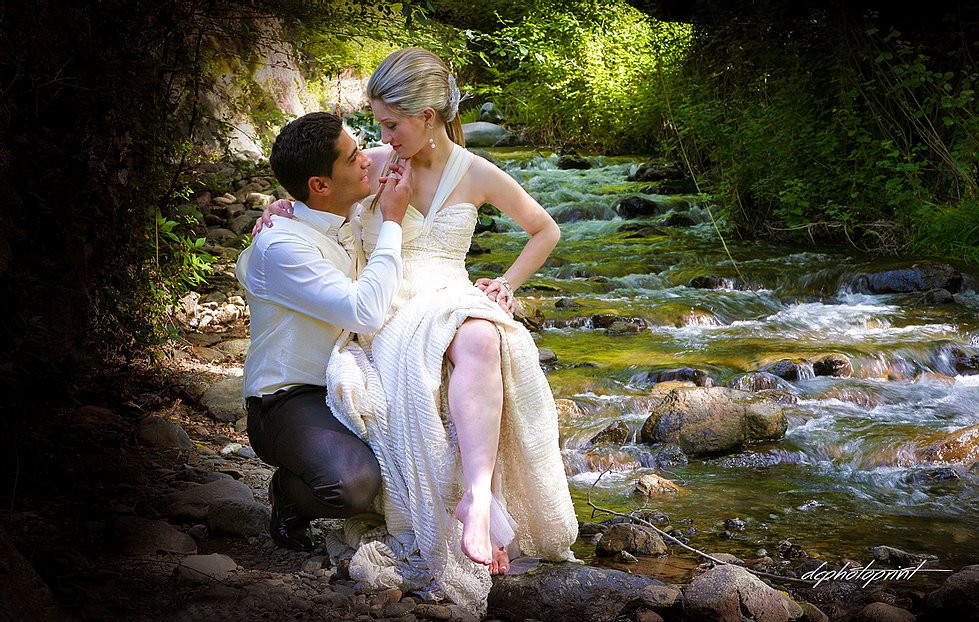 Beautiful and gentle wedding photo session outdoors of the elegant couple by the river after the wedding