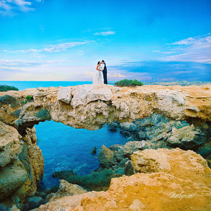 Romantic picture of the marriage couple holding hands after the wedding ceremony outdoors by Protaras beach