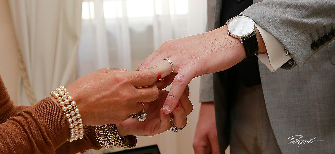 Wedding ceremony. He puts the engagement ring on his finger close-up | nicosia photographer prices for town hall cyprus, nicosia photographers prices for town hall cyprus, nicosia photographers prices  cyprus