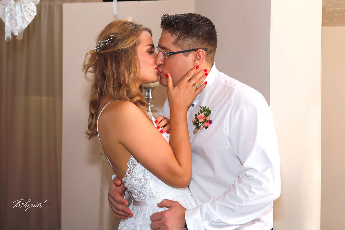 Newlyweds kissing at wedding, Wedding couple enjoying romantic moments | civil ceremony venues in ammos kambouri, Wedding photography at Grecian Bay Hotel - Ayia Napa Cyprus, affordable wedding photographers ayia napa cyprus
