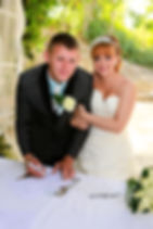 Closeup of young groom signing wedding contract | wedding photographers paphos,wedding photographer prices