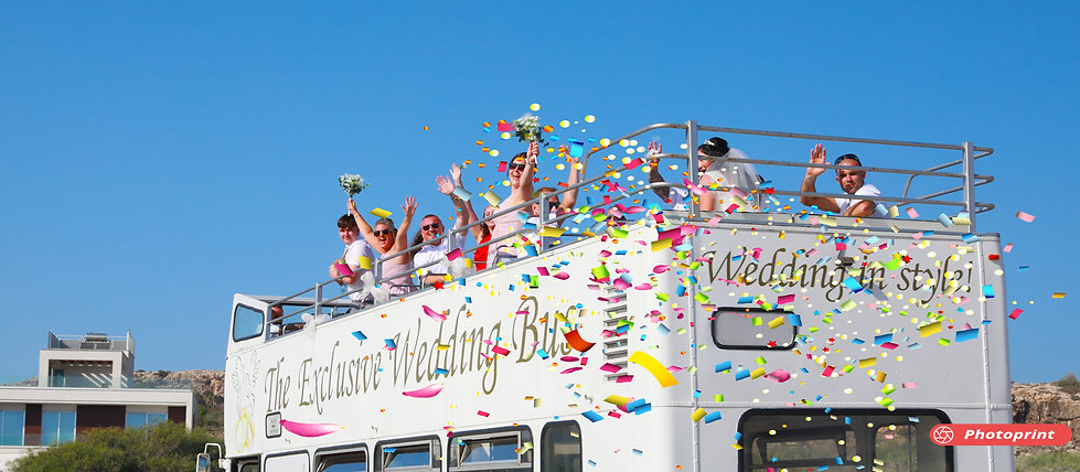 Bride and Groom in confetti shower from the wedding bus celebrate