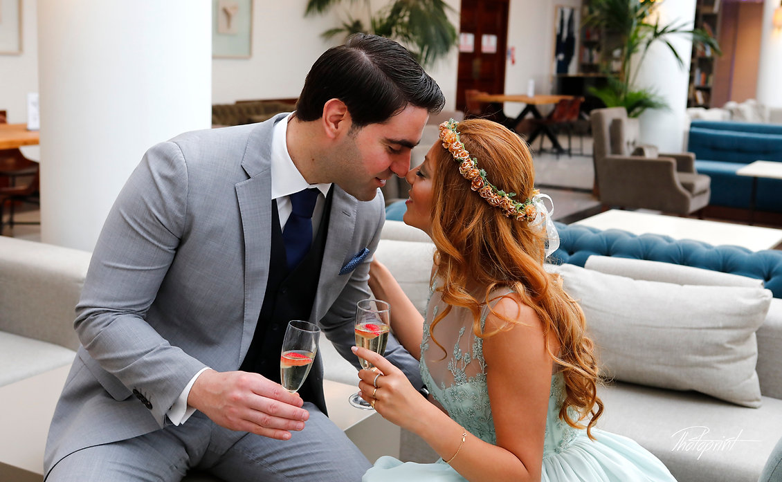 Elegant beautiful Just married couple holding champagne glasses in Hilton Park Hotel | professional wedding photographers nicosia, professional wedding photography nicosia, Bridal wedding photographer nicosia