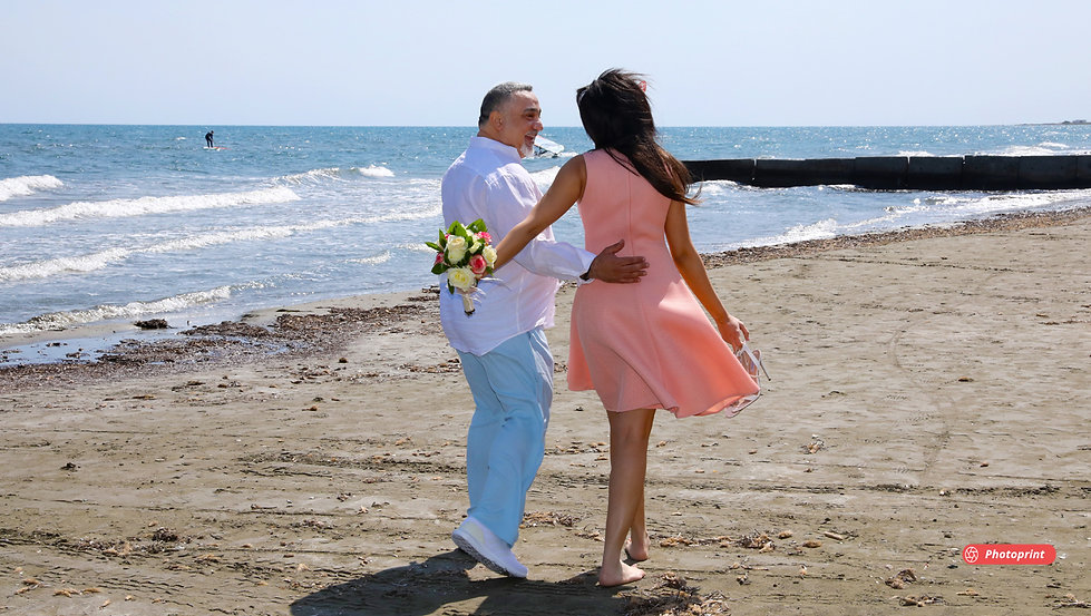 Elegant smiling bride and groom walking on the beach after the wedding | wedding photo ideas protaras cyprus