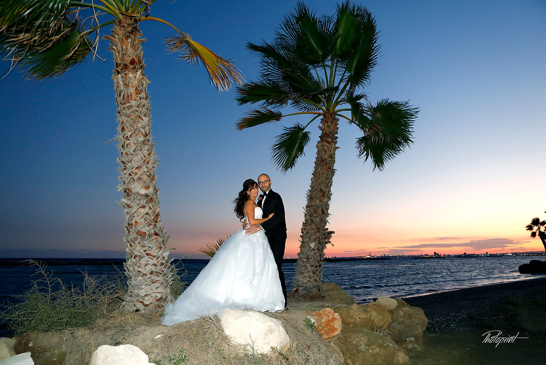 Romantic happy couple, groom kissing his bride next to the sea nigth at Larnaca | Larnaca wedding photographer packages cyprus, larnaca wedding photographer, civil Marriages Aradippou, larnaca cyprus, larnaca wedding photography