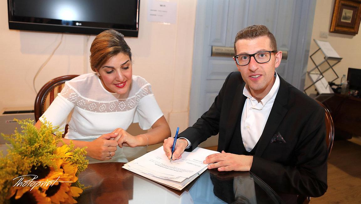Happy young Groom signing wedding registration form in town hall Larnaca | wedding larnaca photographer, wedding larnaca photographers photography