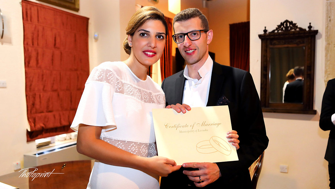 Happy bride and groom show us the wedding contrat after ceremony in Larnaca Municipality | cyprus wedding photos photographer, cyprus wedding Larnaca photography