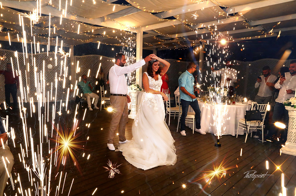 Beautiful wedding dance with fireworks show at the background | wedding photographers for wedding in protaras