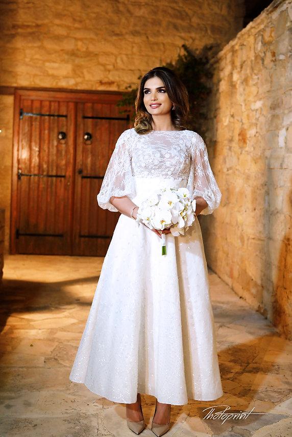 Gorgeous young bride with dark hair in elegant wedding dress posing for photos near Yermasyia Municipality Town hall | cyprus wedding  yermasoyia photographer, wedding yermasoyia photographers cyprus