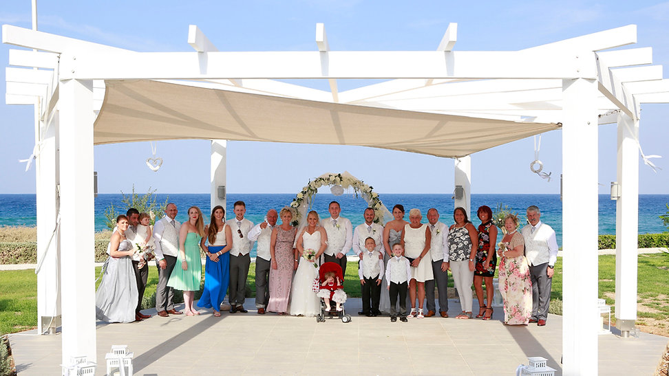 family, guests, bride and groom wedding photo after the wedding ceremony at Pernera Beach Hotel, in  Protaras, cyprus | wedding photographer protaras, professional wedding photographer protaras cyprus