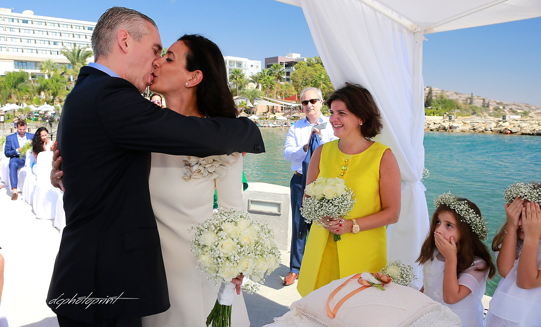 Happy couple after the wedding ceremony Kissing | Limassol cyprus images wedding photography, city hall Protaras wedding photography, bridal photographer  cyprus