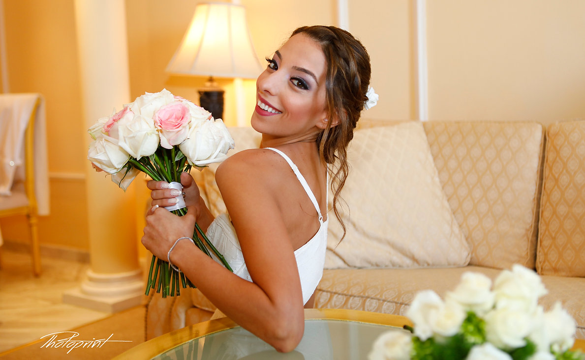 Close-up portrait of gorgeous beautiful bride in white dress with amazing hair style and make up, holding bouquet    cyprus wedding photographers, wedding photography, best wedding photographers in cyprus