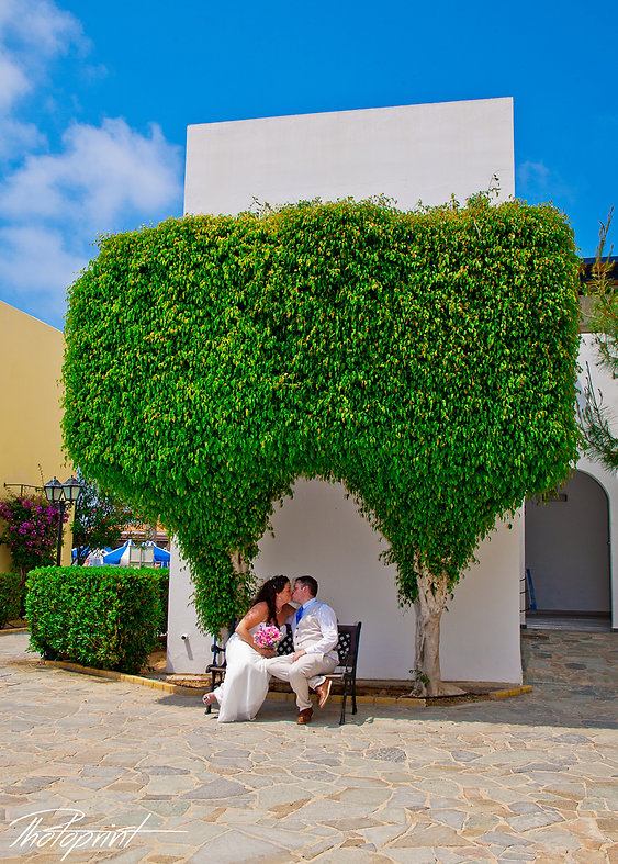 Bride and groom kissing passionately | wedding photo ideas paphos cyprus, weddings in paphos town hall, phototographer in paphos