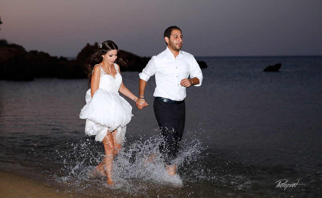 Picture of romantic young couple having a running on the sea shore  | cyprus wedding photography best prices, wedding photography ayia napa cyprus