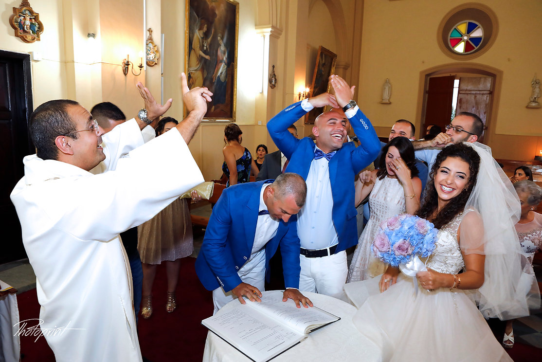 Happy just married young wedding couple celebrating after ceremony inside of the  St Joseph church in Larnaca,Cyprus | wedding photography prices cyprus , paphos lebanese wedding photography , lebanon wedding photographers protaras