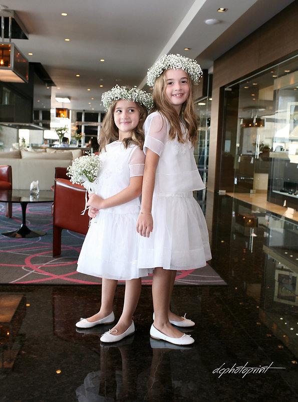 Portrait of two beautiful little girls in wedding dresses  before the wedding at Amathus Beach Hotel, cyprus | cyprus limassol  images wedding venues photography, wedding limassol photographers photography