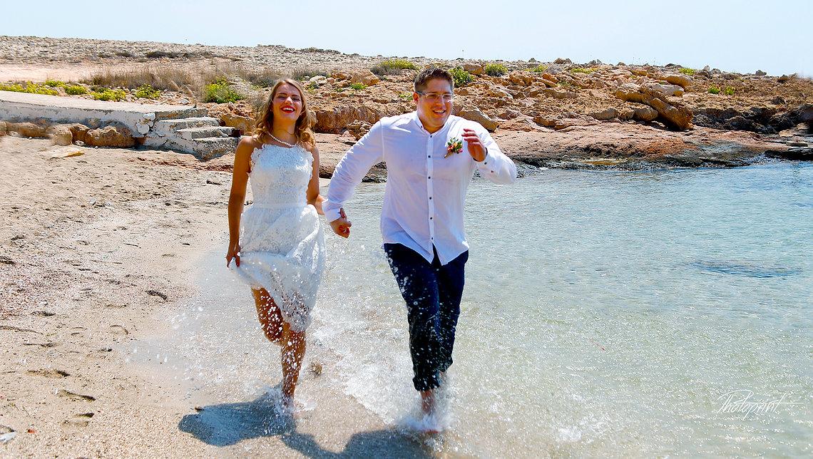 Couple running at ayia napa beach holding hands smiling | ayia napa cyprus photography, ayia napa wedding cyprus photography, cyprus wedding ceremony