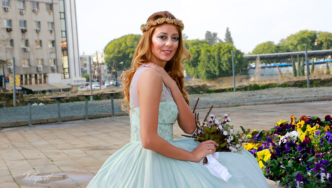 Gorgeous young bride with blode hair in elegant wedding dress posing for photos near Nicosia Municipality Town hall |  wedding photographer nicosia cyprus, wedding photographers nicosia cyprus, Nicosia wedding photographers cyprus
