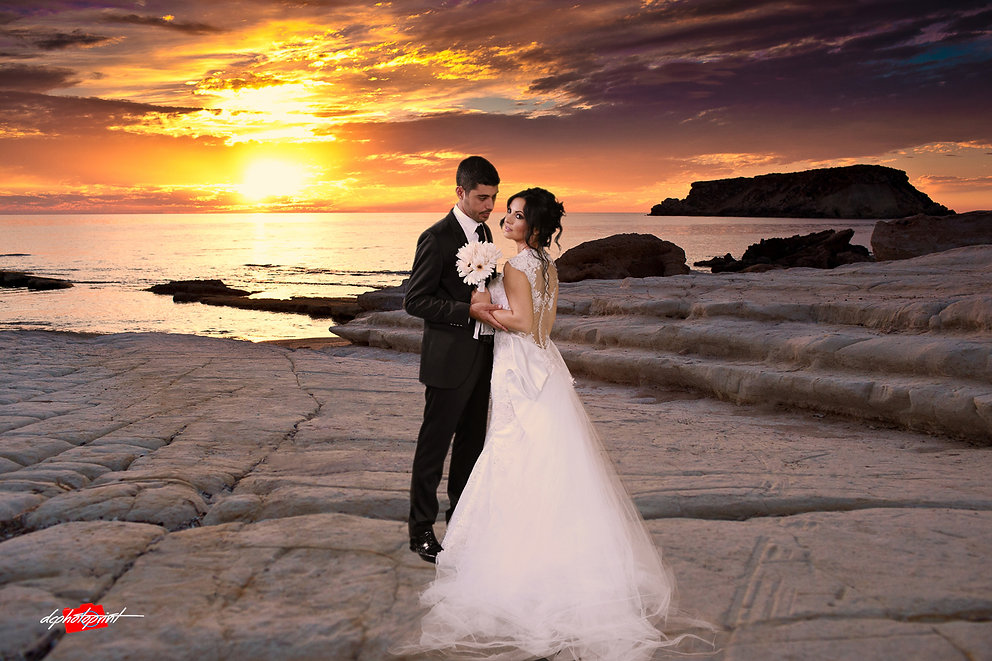 Happy just married young wedding couple celebrating and have fun at beautiful beach sunset | cyprus sunset images wedding photography paphos, wedding photographer in paphos cyprus