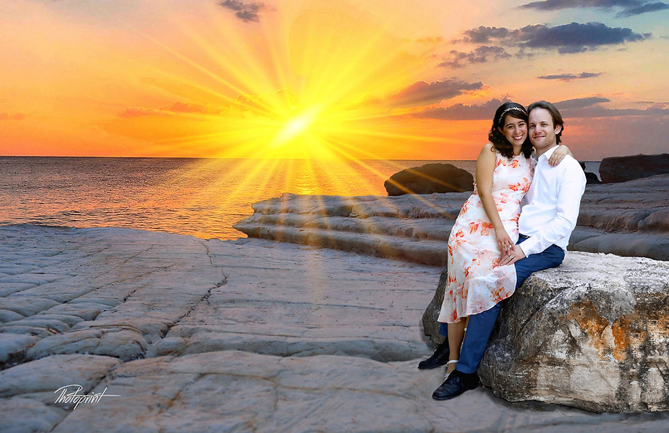 Young couple enjoying romantic moments after the wedding, sunset at the background