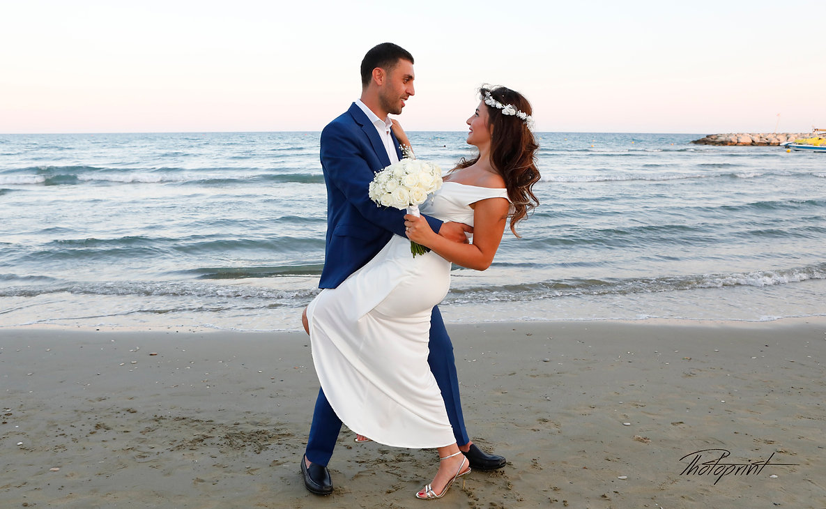 Picture of romantic young couple on the sea shore | wedding venues in Larnaca cyprus, wedding venues Larnaca