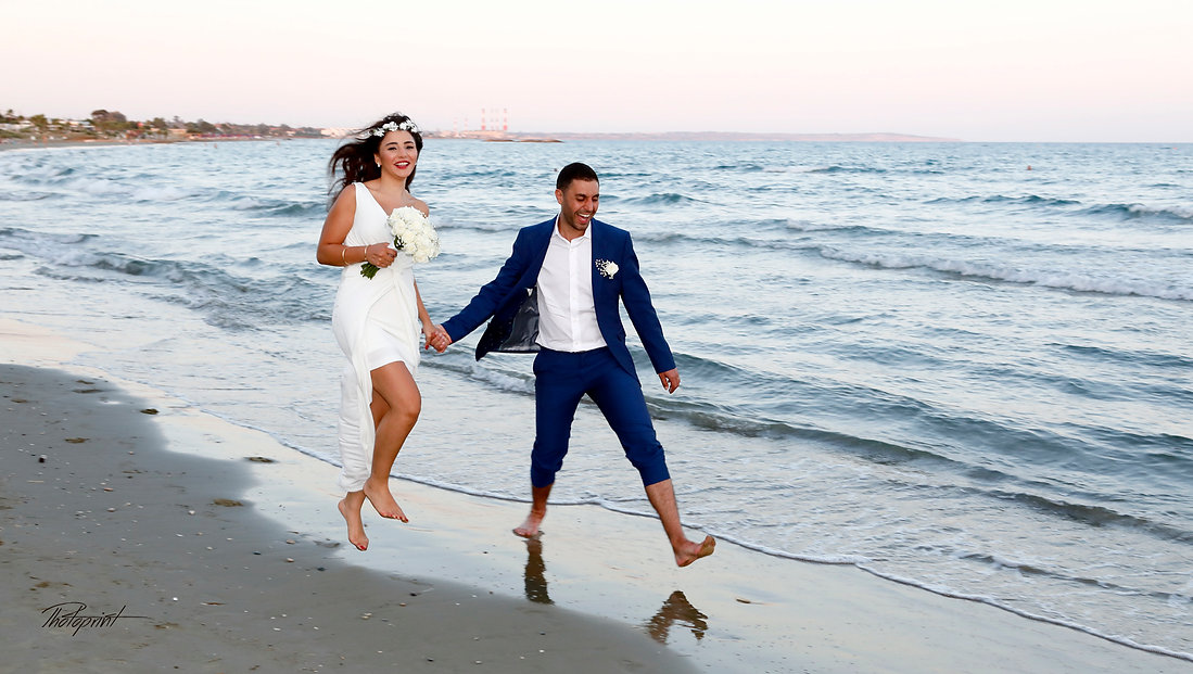Amazing picture of romantic young couple having a walking on the sea shore  | cyprus wedding photography best prices, Larnaca beach hotel wedding photography
