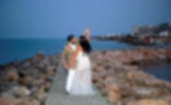 Happy just married young wedding couple celebrating by the Protaras beach